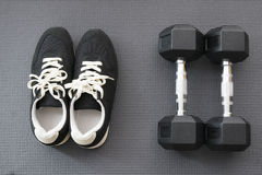 Shoes and Dumbbells on Yoga Mat. Ready for workout Stock Photography
