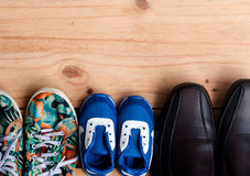 Shoes for the entire family on wooden floor. Shoes for the entire family on the wooden floor Stock Image