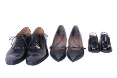 Shoes of Family. Footwear families, isolated on a white background Royalty Free Stock Images