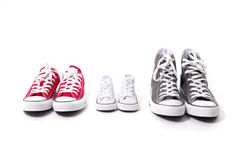 Shoes in father big, mother medium and son or daughter small kid size in family love concept. Three pair of shoes in father big, mother medium and son or Royalty Free Stock Photo