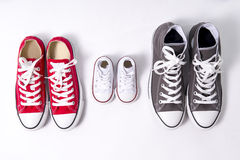 Shoes in father big, mother medium and son or daughter small kid size in family love concept Stock Photo