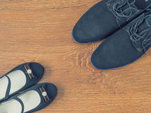 Shoes father and daughter`s shoes on the wooden floor. Royalty Free Stock Images