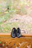 Shoes on Fence. Black shoes on wooden fence Royalty Free Stock Photography