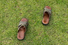 Shoes on the field Royalty Free Stock Photos