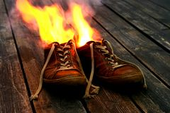 Shoes on fire Royalty Free Stock Image