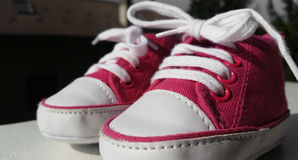 Shoes for the first steps in the world Stock Images
