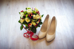 Shoes and flowers Royalty Free Stock Image