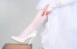 Shoes at the foot of the bride Royalty Free Stock Image