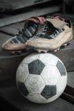 Shoes & football Royalty Free Stock Photo