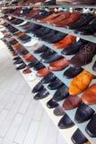 Shoes, footwear. Men shoes on shelves in footwear shop Royalty Free Stock Photo