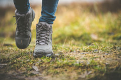 Shoes in a forest. Feet in shoes on a forest path Royalty Free Stock Photo