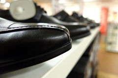Shoe store. Shoes forming a straight orderly line Stock Photography