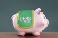 Shoes fund piggy bank Stock Images