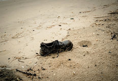 Shoes Garbage beach Stock Photography