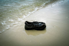 Shoes Garbage beach Royalty Free Stock Photos