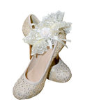 Shoes with garter for bride Royalty Free Stock Photography