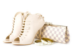 Shoes, golden jewelry and handbag Royalty Free Stock Photography