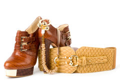 Shoes, golden jewelry and strap Stock Photos