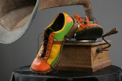 Shoes and grammofon. Grammofon boots and a vintage-style retro Royalty Free Stock Photo