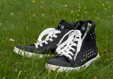 Shoes on the grass. Summer concept - female shoes on the green grass Stock Image