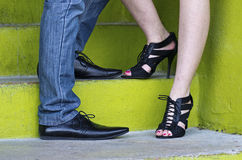 Shoes &  Green Steps of Engaged Couple Stock Photos
