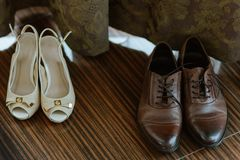 Shoes of the groom and the bride. Wedding pair of shoes of the groom and the bride standing isolated Stock Image