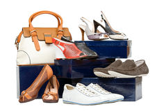 Shoes and handbag on boxes over white. Background Stock Images