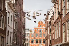 Shoes hang in city Royalty Free Stock Image