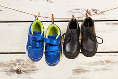 Shoes hanging on clothesline. Royalty Free Stock Image