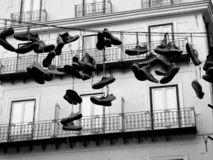 Shoes hanging over a street in Palermo. Canvas shoes hanging over a street in Palermo, Sicily royalty free stock photography