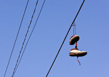 Shoes dangling from power line royalty free stock image