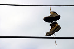 Shoes Hanging from a telephone wire Stock Photography