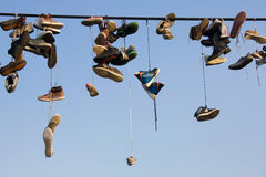 Shoes hanging on wire Stock Photo