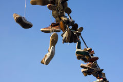 Shoes hanging on wire Stock Images