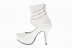 Shoes heeled  leather white with chains bright, style boots  for women on white background Stock Image