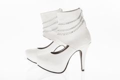 Shoes heeled  leather white with chains bright, style boots  for women on white background Royalty Free Stock Photo