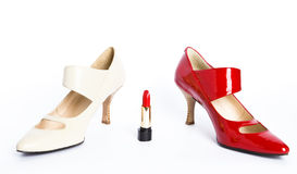 Shoes on a high heel and lipstick Stock Photography