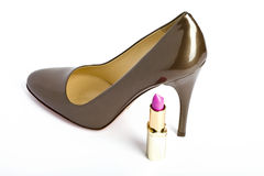 Shoes  a high heel and lipstick Royalty Free Stock Photography