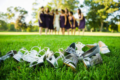 Shoes and high heels laying on the grass Stock Image