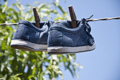 Shoes hung out to dry Stock Photography