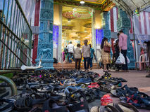 Shoes at an Indian Temple. Hundreds of shoes left outside an Indian temple in Singapore whilst worshippers are inside Stock Photos
