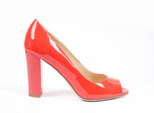 Shoes isolated on a white background. red patent leather, side view Royalty Free Stock Images