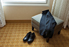 Shoes and Jacket in a Hotel Room Royalty Free Stock Photos
