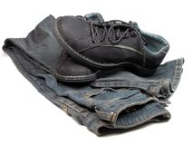 Shoes and jeans. Sports shoes and blue jeans over white background Royalty Free Stock Images