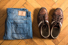 Shoes and jeans on the floor Stock Photo