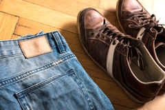Shoes and jeans on the floor Stock Images