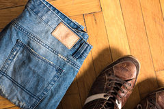 Shoes and jeans on the floor Royalty Free Stock Photography