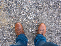 Shoes, jeans and gravel Stock Photo