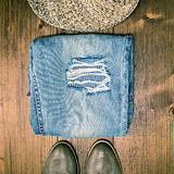 Shoes Jeans and Hat on Wooden Floor Stock Photography