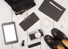 Shoes, jeans, tablet pc, camera, notepad, essentials and chalkbo. Travel concept - shoes, jeans, tablet pc, camera, notepad, essentials and chalkboard on white Royalty Free Stock Photo
